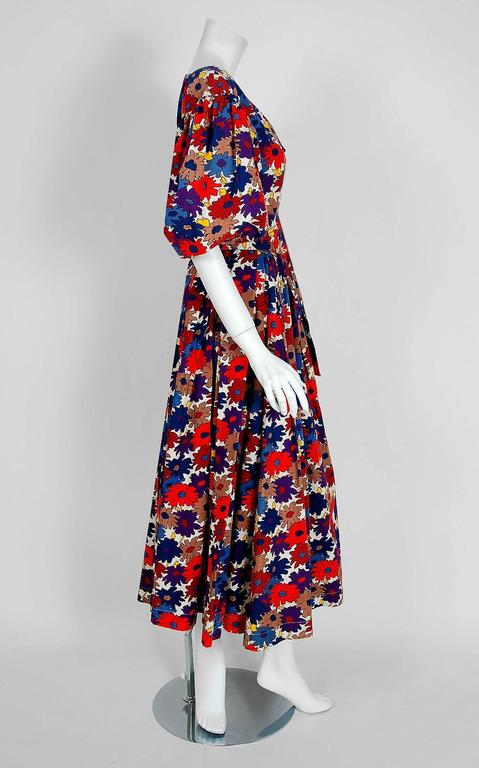 Breathtaking Yves Saint Laurent colorful floral garden print cotton ensemble from the infamous Rive Gauche collection during the mid-1970's. Pieces from this decade are very rare and are true examples of fashion history. I adore the low plunge