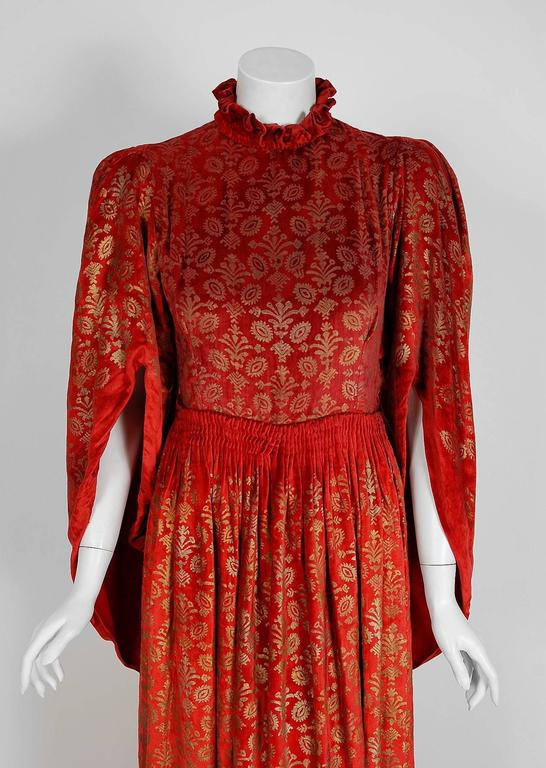 Breathtaking Maria Monaci Gallenga Couture trained gown dating back to the early 1920's. The textile art of Gallenga is often compared to that of Mariano Fortuny because they both produced hand-stenciled designs that drew inspiration from the