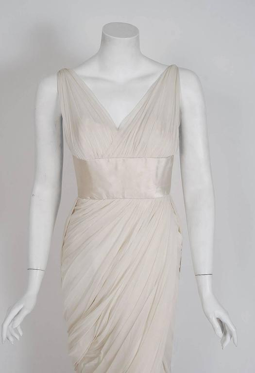 Jean Desses is one of the most important designers of the 20th century and was a designated Haute Couture house under the official Chambre Syndicate de la Couture. This exquisite 1950's goddess gown is a rare design made for the American market