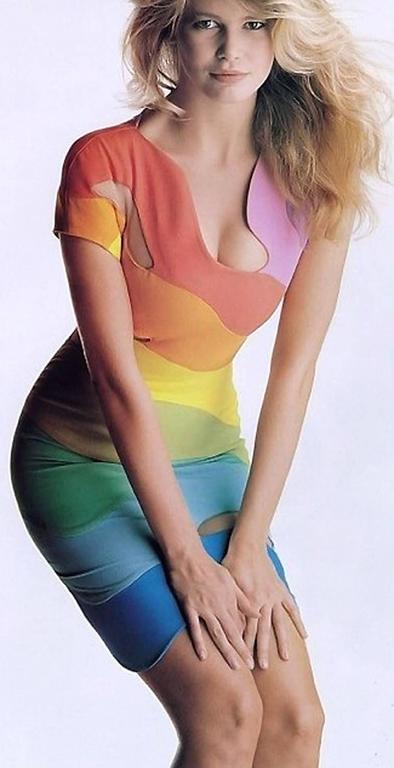 Iconic 1990 Theirry Mugler Couture documented rainbow swirl dress in the most flattering body-con shape! This legendary French fashion designer is known for bold fashion and edgy, sometimes even campy, theatricality. In the 1980's, he was famous for