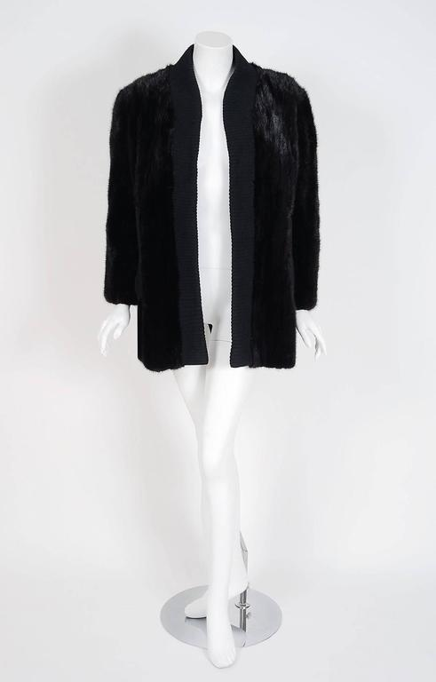 This exquisite late 1960's Pierre Cardin Couture genuine mink-fur and knit cardigan jacket will make any woman shine during the upcoming colder months. The soft dark mink been worked into vertical panels and the effect is really breathtaking. The