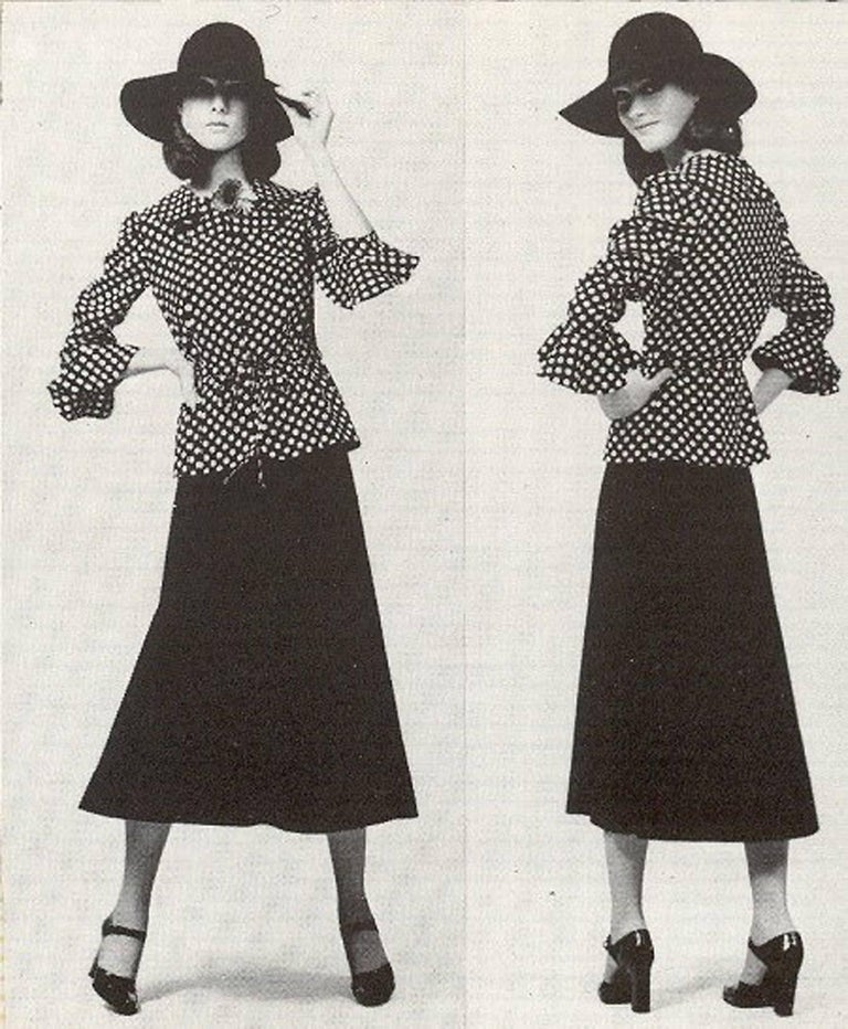 Gorgeous Yves Saint Laurent black and white polka-dot print rayon ensemble from the famous fall/winter 1974 Rive Gauche collection. Pieces from this decade are very rare and are true examples of fashion history. The bodice has a ultra chic ruffle