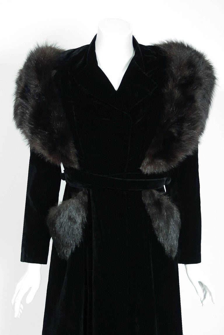 Breathtaking early 1940's A.W.B Boulevard designer coat in the most fabulous black silk-velvet and genuine fox-fur combination. The construction is impeccable and has the type of seamed pattern work one rarely sees today. The garment has the most