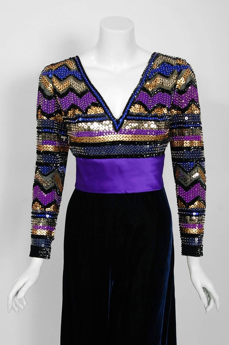 Exquisite Pierre Balmain Haute-Couture dark blue silk-velvet jumpsuit ensemble dating back to his opulent 1971 collection. This iconic designer created a very sculptural quality which was always allied with a ladylike essence. His garments have a