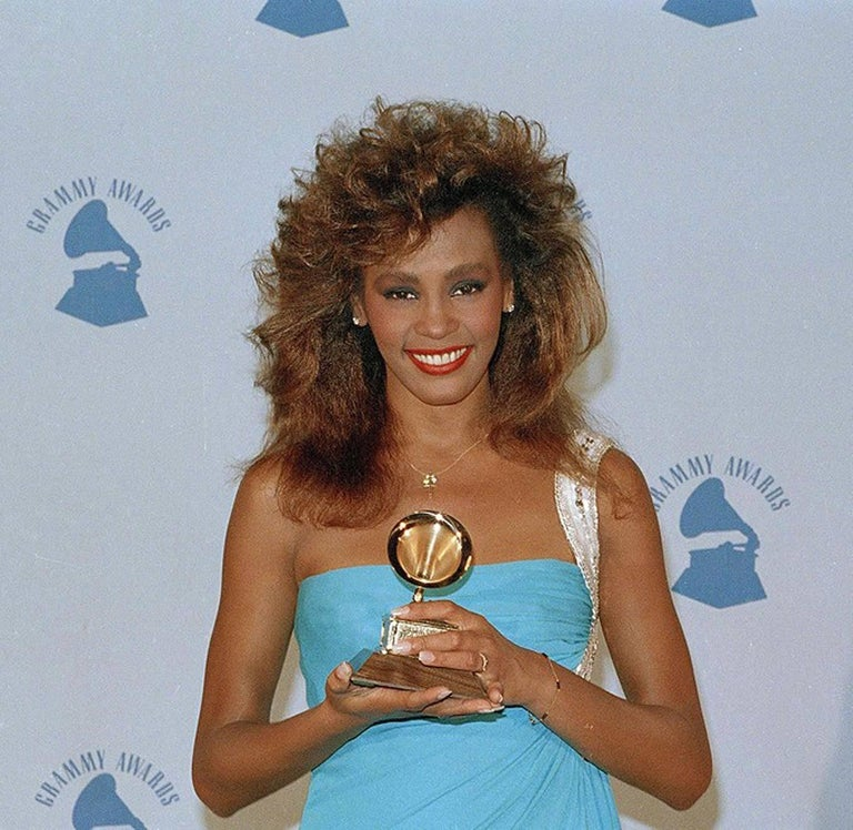 Breathtaking 1986 Travilla Couture blue silk-jersey goddess gown which happened to also be Whitney Houston's choice design for the 28th Grammy Awards where she won for best female vocal performance.  William Travilla designed costumes for films and