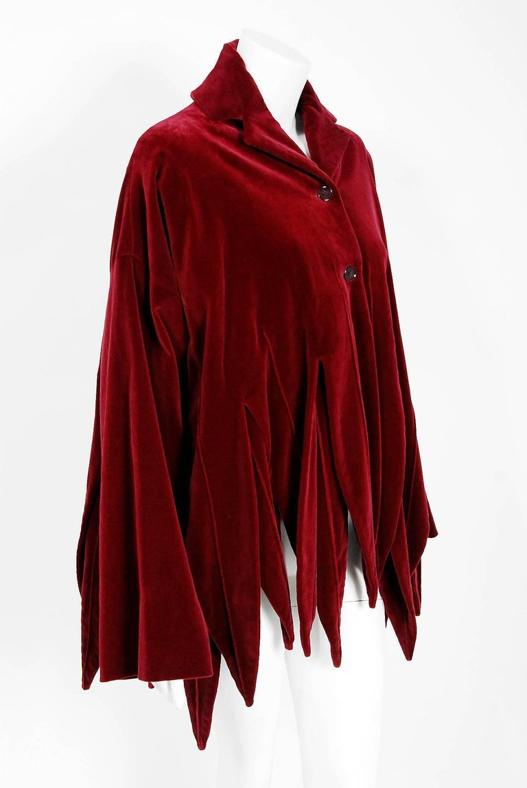 Breathtaking 1987 Romeo Gigli runway 'Jester' designer jacket in the most fabulous burgundy-red velvet. The twin version of this gorgeous piece is held in the permanent archives of The Metropolitan Museum. The construction is impeccable and has the