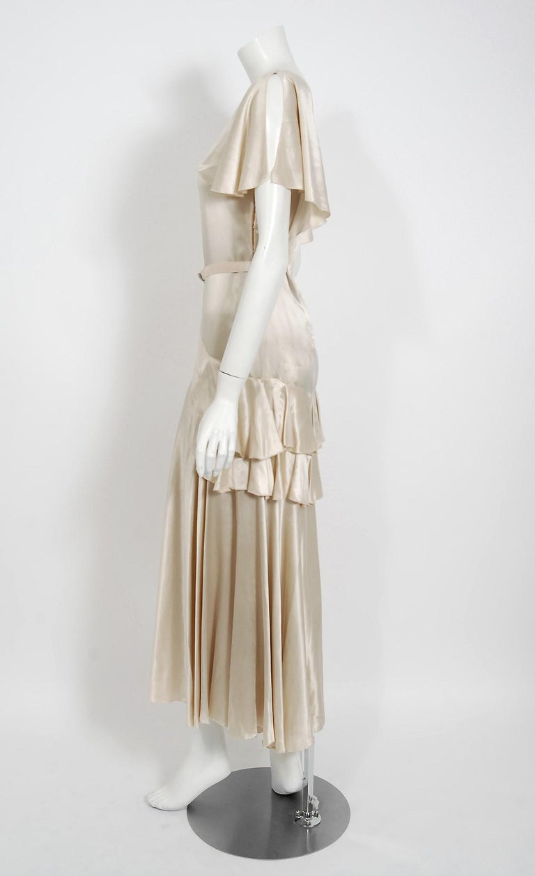 Women's 1930's Ivory Creme Satin Flutter Sleeve Plunge Belted Bias-Cut Tiered Deco Gown