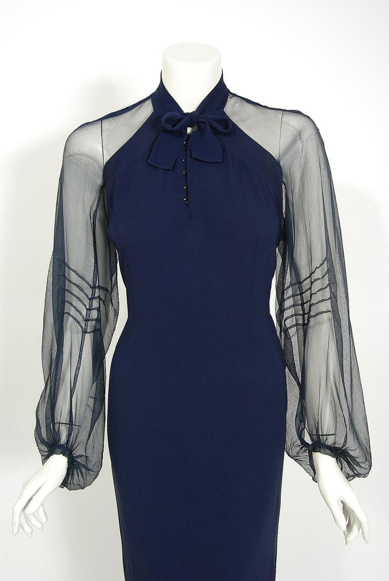 A breathtaking 1936 Germaine Monteil Couture navy crepe gown which was also worn by Anne Nagel in the Warner Brothers film