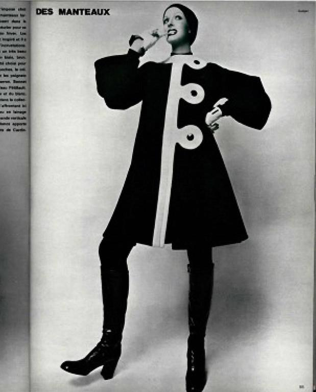 Breathtaking 1960's Pierre Cardin designer coat in a rich fully-lined black and ivory wool. In 1951 Cardin opened his own couture house and by 1957, he started a ready-to-wear line; a bold move for a French couturier at the time. The look most