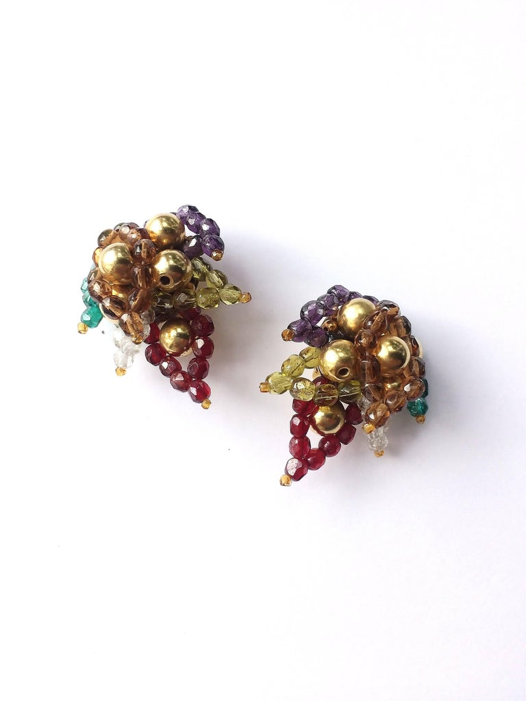 Fresh and warm colours, highlighted with gilt balls, make these earrings, by Coppola e Toppo from the 1960s, stylish and glamorous. Made with Bohemian half crystal beads, in a three dimensional 'paisley leaf' design, they are light and easy to wear.