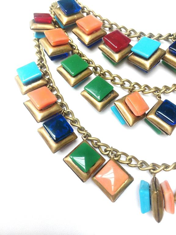Striking three row glass square 'charm' necklace. 2