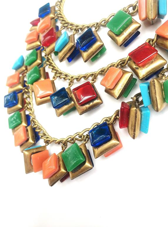 Striking three row glass square 'charm' necklace. 4