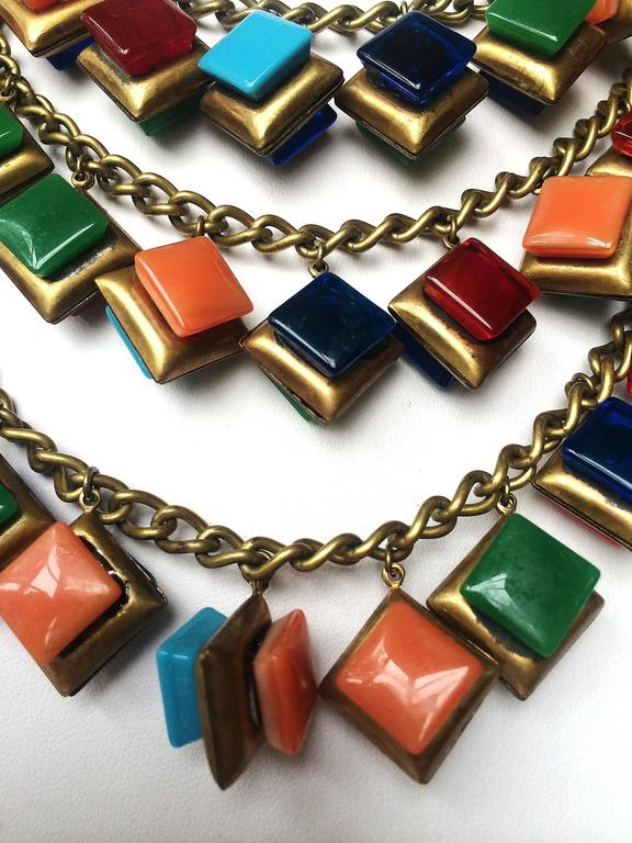 Striking three row glass square 'charm' necklace. 5