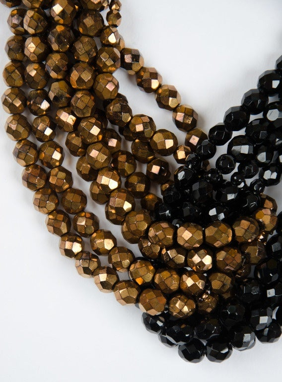 A beautiful multi row twisted necklace by Coppola e Toppo, composed of black and bronzed half crystal beads, forming an elegant 'knot' in the centre of the necklace, with compounded bead terminals at rear, with signature clasp. Bruno and Lyda