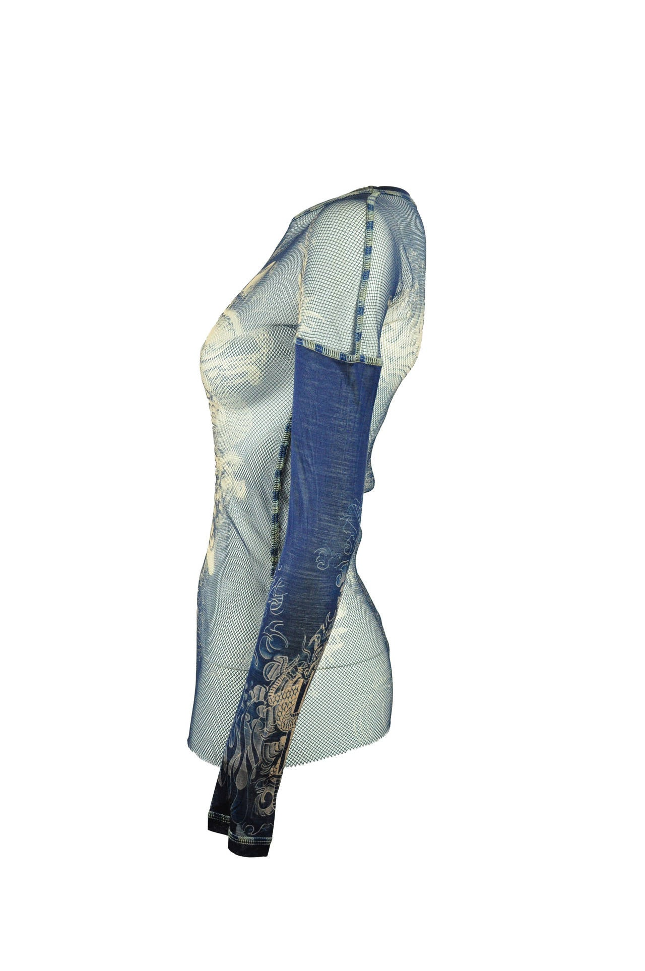 A very iconic tattoo print mesh top from Jean Paul Gaultier, long sleeves in silk Size is small.