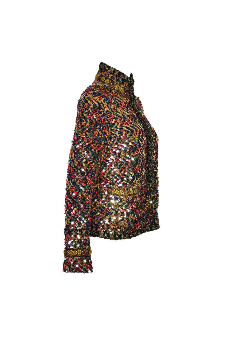 A glittering, colorful and gold-toned sequined tweed jacket from Chanel Paris-Bombay collection.  Hook and eye closure through front with two pockets.