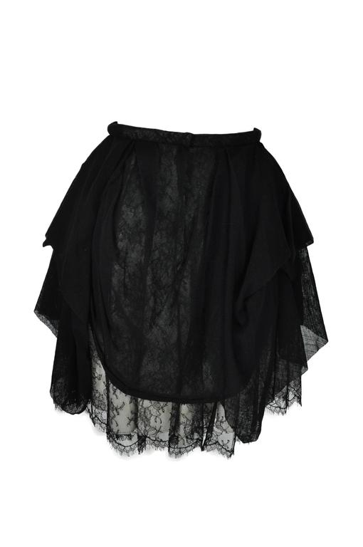 A black asymmetric tulle overlay lace skirt from Chanel 2010 collection.  Fully lined.