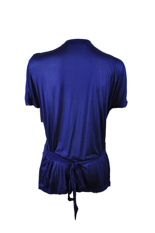 A round-neck short sleeves top in sapphire blue with multi-colored sequins on front and a waist tie.