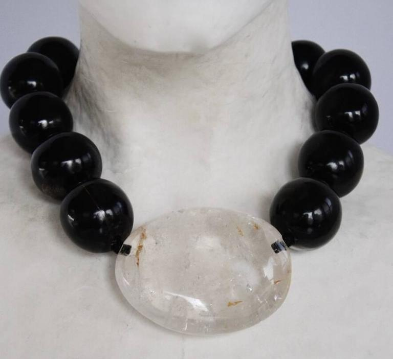 Ebony wood bead and rock crystal one of a kind necklace from Monies. Rock crystal is 2.5
