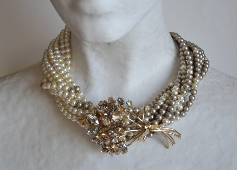 Gorgeous two tone glass pearl necklace from Philippe Ferrandis. Features a Swarovski Crystal bouquet motif.