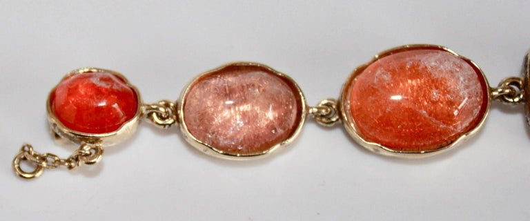 Hand painted rock crystal bracelet in shades of pink/salmon from Goossens Paris.