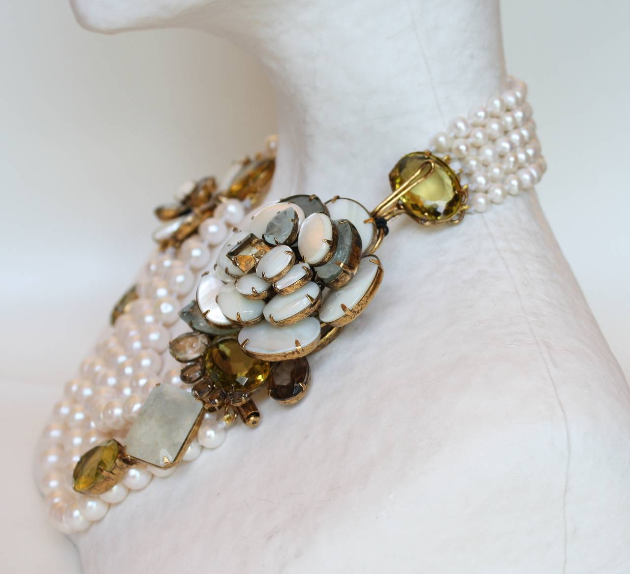 Iradj Moini necklace made with six strands of fresh water pearls with citrine, aquamarine, and mother of pearl details. Large flower is detachable and is a pin.