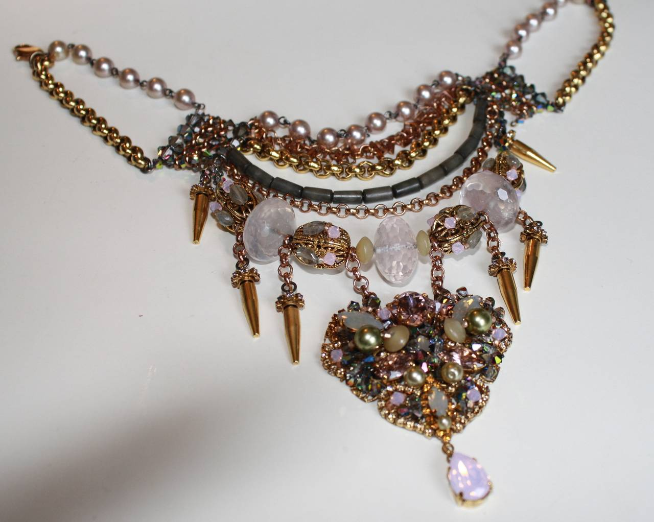 """Vintage Erickson Beamon """"Xanadu"""" necklace with rose gold chain, """"dirty"""" gold spikes, and Swarovski crystal detailing.  12.5"""" width with 3"""" extra chain  3.5"""" drop  Designer Biography:  Founded and designed by Detroit natives Karen & Eric"""