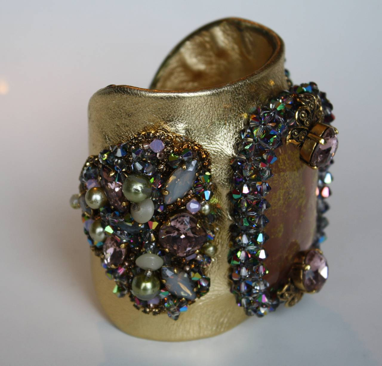"Erickson Beamon ""Xanadu"" Cuff with apricot cabochon, green pearls and Swarovski crystals on gold metallic leather.