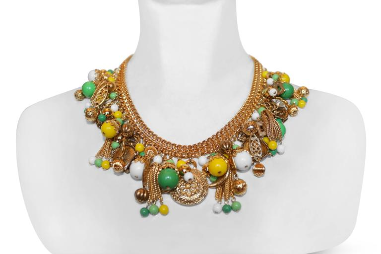 Francoise Montague choker necklace made with handmade green, yellow and white glass bead charms on gold metallic treatment. The height of luxury.