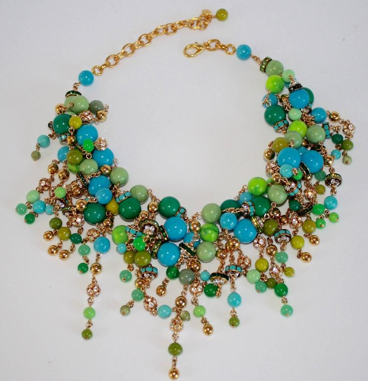"""Glass beads are twisted and strung together along with Swarovski crystals in this fabulous necklace from French designer Francoise Montague.  15"""" W with 4"""" extra chain to back  Designer Biography:  La maison Françoise Montague has been"""