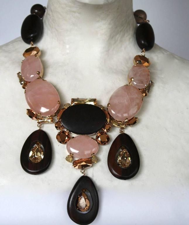 Brown and pink glass cabochon, wood, and Swarovski Crystal large triple drop  necklace from Philippe Ferrandis.