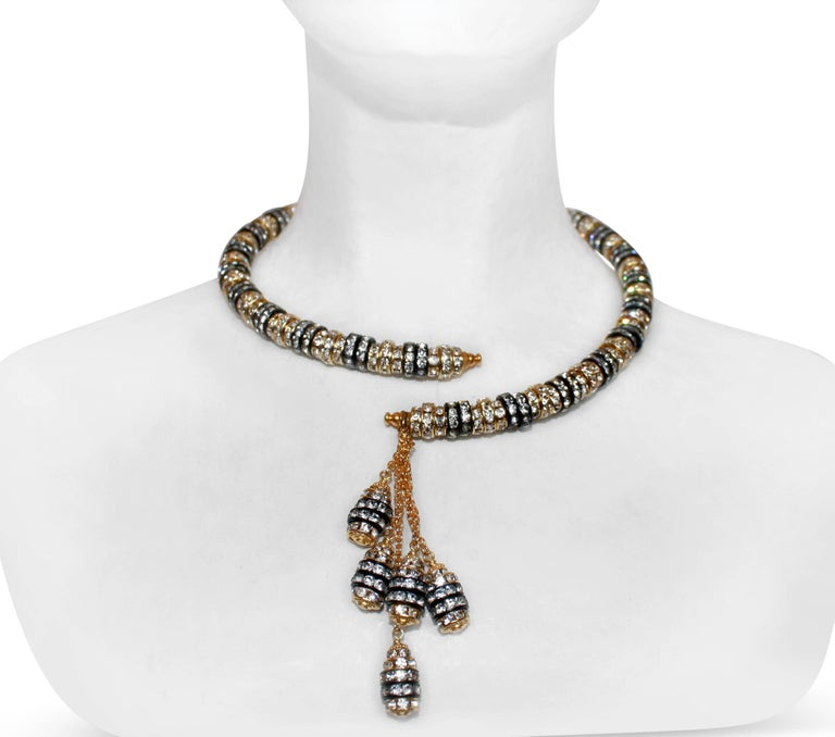 Swarovski Crystal rondelles set in a mix of yellow gold and rhodium are strung on molded wire, creating an easy to wear and elegant necklace from Francoise Montague.