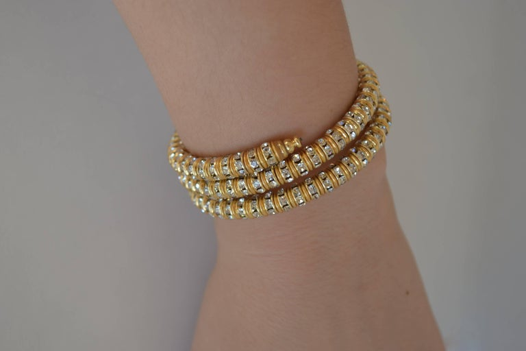 Memory wire wrap bracelet with clear crystal and gold rondelles from Francoise Montague. Fits most wrists both large and small and is easy to take on and off.