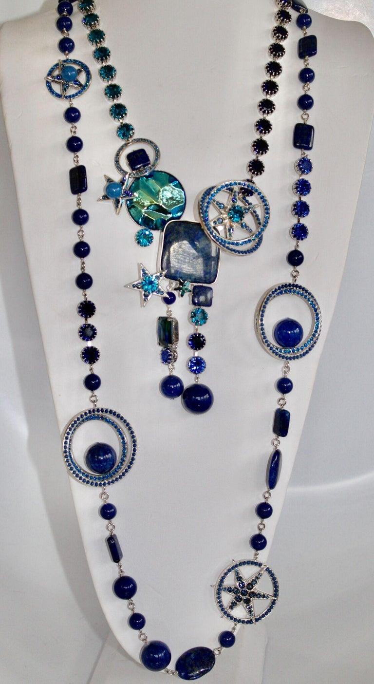 Long sautoir by Philippe Ferrandis with 3 dimensional motifs in shades of blue Swarovski crystal.