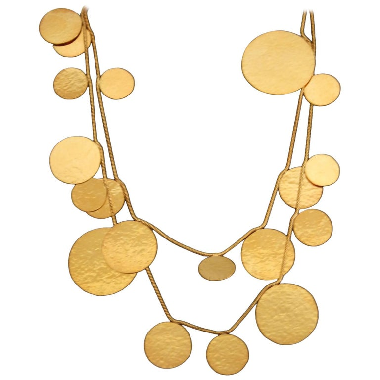Long hand hammered gold plated brass sautoir necklace from Herve van der Straeten. Can be doubled or worn long - extremely lightweight.   This designer is no longer producing jewelry, making all remaining pieces collector's items. As such, prices