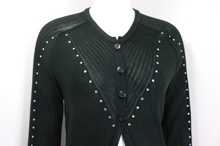 - Sonia Rykiel black cotton knitted long sleeves cardigan sweater.   - Embedded rhinestones from front all the way to the sleeves .   - Four front buttons closure.   - V- neckline.   - Size 40.   - 100% Cotton.