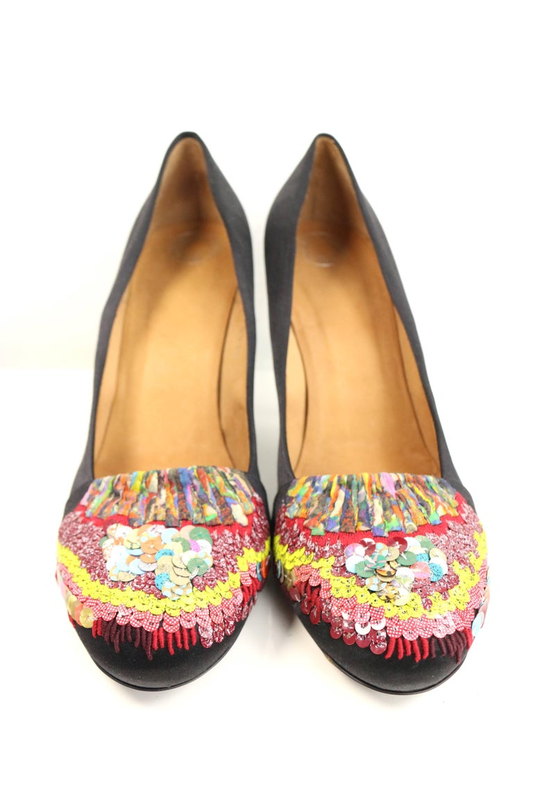 - Dries Van Noten black silk pumps.   - Featuring rainbow colour sequins at the toe cap.   - Silver toned hardware thin heels.   - Size 39.