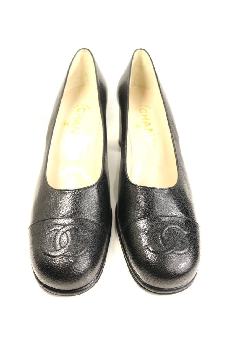 - Vintage 90s Chanel black caviar square toe shoes.   - Featuring a