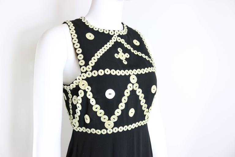 - Vintage 90s Frank Sorbier haute couture black embroidered mother of pearls button maxi dress. Elegant, once and only design and only available in OnceStyle.   - Embroidered white shell buttons.   - Height: 148cm I Shoulder: 6cm I Bust: 40cm I