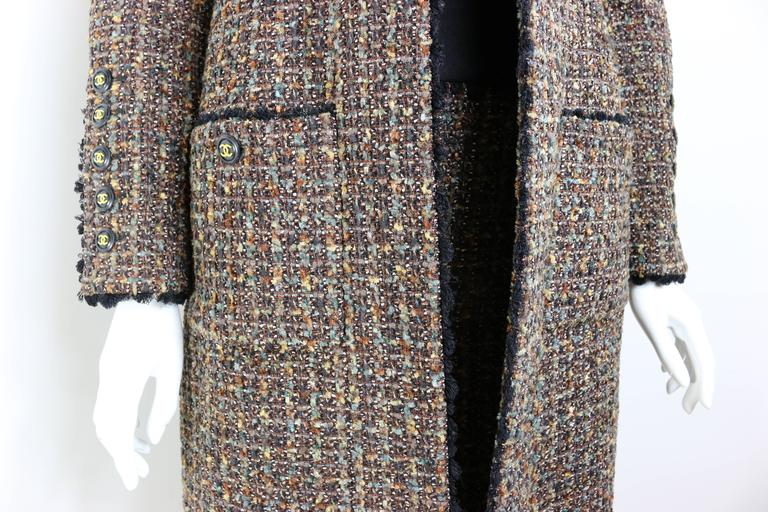 - Vintage Chanel brown/yellow/green/white/black wool tweed long coat and dress from fall 1994 collection.   - Featuring four front pockets buttons and five buttons on each cuff.   - Straight lined coat.   - Black trimming throughout the coat and