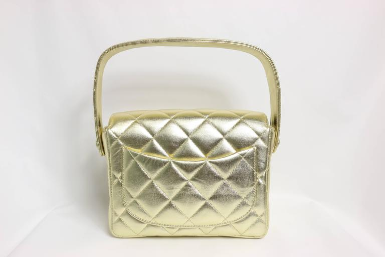 - Chanel gold metallic lambskin leather quilted mini flap handbag from 1996 to 1997 collection.   - Long: 17cm I Height(with strap): 19cm I Width: 6cm.   - Include: Dust bag, Authenticity Card.