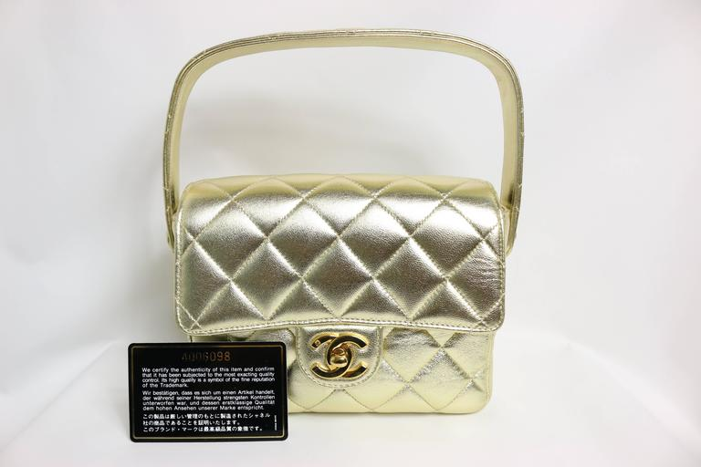 Chanel Gold Metallic Lambskin Quilted Mini Flap Handbag   In Excellent Condition For Sale In Sheung Wan, HK