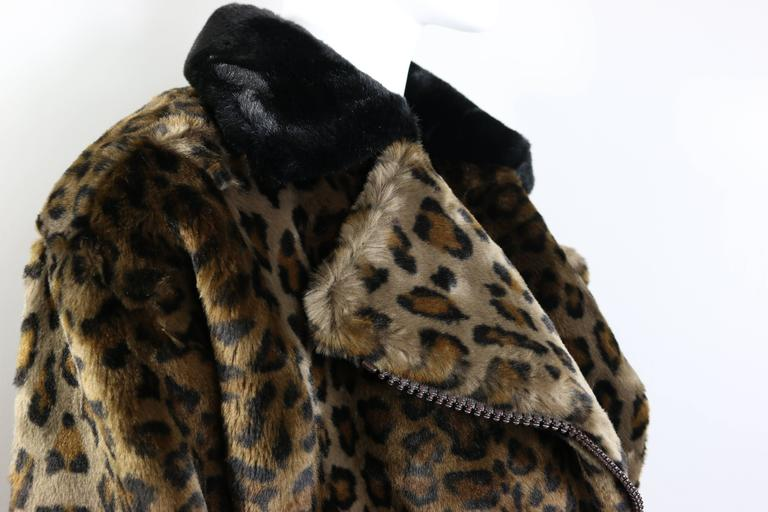 - Vintage 90s Nina Ricci animal leopard-print faux fur coat. 