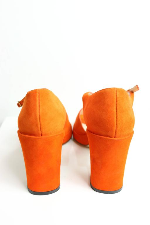 - Vintage 90s Chanel orange suede open toe strap heels. 