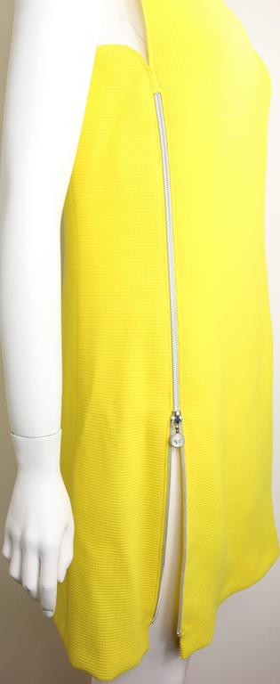 - 90s Gianni Versace Couture yellow dress with vertical Medusa zipper closing on the right and horizontal zipper closing on the left. Classic cut with a twisted.   - 87% Wool, 13% Silk.   - Height: 33.5in I Bust: 33in I Waist: 32in  - Size 38.   -