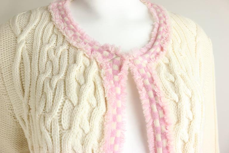 - Chanel white pink fringe trim knitted pattern cardigan sweater from 2005c collection.   - Featuring no front closure and two front fringe trim pockets.   - Made in France.   - Size 42