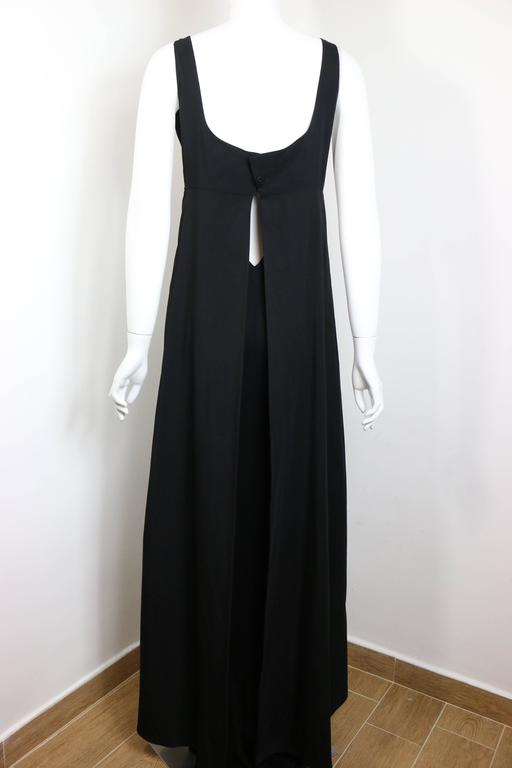 - Chanel black square neck A-Line jersey with split cut at the back maxi dress from 1998 collection.   - Featuring two layers that first layer is wrapping around the second layer and split cut at the back. Side zipper closure, two side pockets and