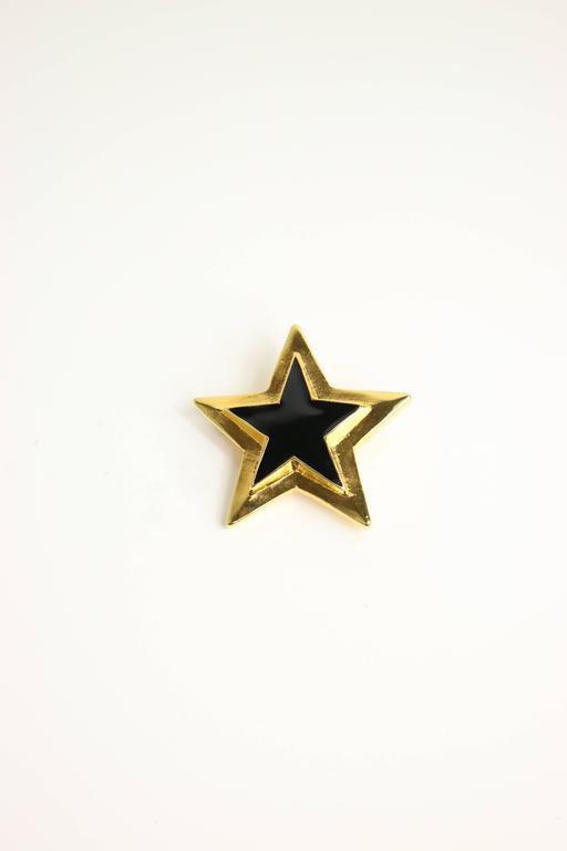 - Vintage 80s Escada gold/black star brooch.   - Length: 2.5in