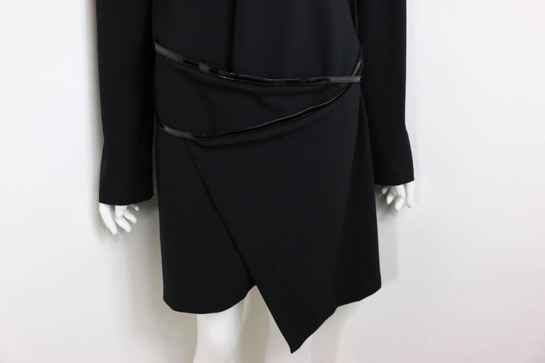 - Gucci by Tom Ford iconic 90s mini black dress from Fall 1997 collection. 