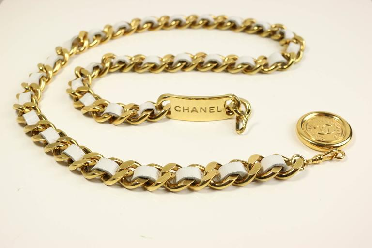 "- Chanel white leather gold tone chain belt with ""CC"" logo medallions from 95 collection.   - Length:30in I Height: 04in (measurement is approximate).   - Made in France.   - Including: Original case.   - Please note this vintage item is"